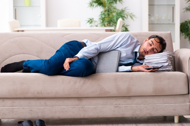 Businessman sleeping on his couch